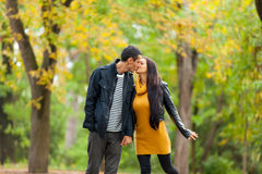 Photo of cute couple kissing on the wonderful autumn park backgr Stock Photos