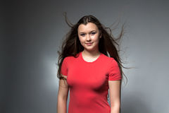 Photo of cute girl with long flowing hair Stock Image