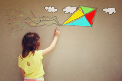 Photo of cute kid imagine flying kite. set of infographics over textured wall background.  Royalty Free Stock Photos