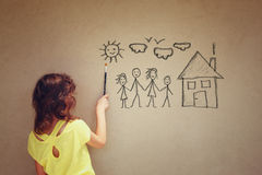 Photo of cute kid imagine a happy family. set of infographics over textured wall background Stock Photography