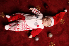 Photo of cute little sleeping baby in Santa Hat Stock Photo