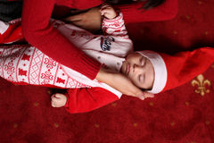 Photo of cute sleeping little baby in Santa Hat Stock Photos