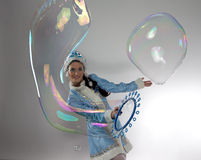 Photo of cute snow maiden with soap bubbles Royalty Free Stock Photo