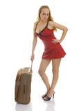 Photo of the cute woman with suitcase. Royalty Free Stock Photography