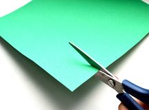 A photo of cutting a green paper stock photos