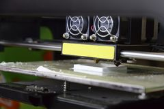 Photo of 3d printer, 3d print, theme of electronic innovation. Close-up royalty free stock images