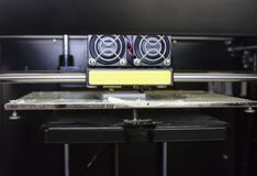 Photo of 3d printer, 3d print, theme of electronic innovation. Close-up stock images