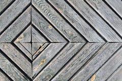Photo d'une pièce de porte d'un bois en forme de diamant, fond, texture en bois image stock