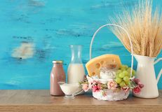 Photo of dairy products over wooden table. Symbols of jewish holiday - Shavuot stock photography