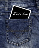 Photo dans une poche de jeans Photo stock