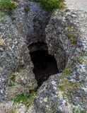 Photo of dark cave hole in the rock Royalty Free Stock Image
