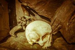 Photo of dark human skull. In front of Camaldoli hermitage stock images