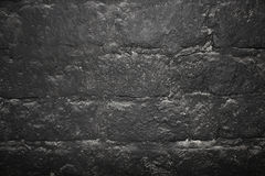 Dark stone wall texture background Stock Photos