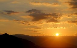 Photo dawn bright over the mountains. Photo of a miracle dawn bright over the mountains and the city Stock Images