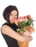 Belle femme avec des fleurs Photographie stock libre de droits