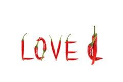 Photo de l'amour de mot écrit avec des poivrons de piment rouge Photos libres de droits
