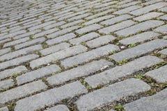 Photo de plan rapproché du pavage en pierre gris de bloc Images stock