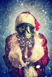 Photo de Santa Claus avec le masque de gaz Image stock
