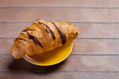 Photo of delicious fresh croissant on the wonderful brown wooden Royalty Free Stock Images