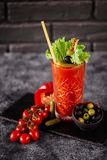 Photo of delicious tomato bloody mary cocktail. On reflecting stone table with spot light royalty free stock images
