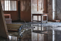Photo from demolition  textile  factory. Hall with water reflection Stock Photography