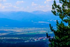 Photo depicting a beautiful colorful mountain landscape, summert. Ime. Europe, Bulgaria, Bansko village, ski and snowboard resort. Panoramic view Stock Photo