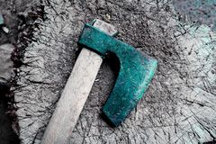 Photo depicts iron rusty  but very sharp old wooden ax blade, pl. Aced on a timber with chopping trace. Axeman equipment tool concept. Ax and ax handle Royalty Free Stock Photo