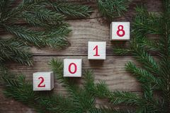 Photo des brins et des cubes d'arbre de Noël avec le numéro 2018 Images libres de droits