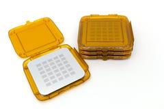 Photo des photomasks pour le processus de photolithographie boîtes oranges photographie stock