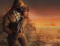Desert post-apocalyptic soldier standing with rifle