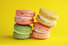 Photo of dessert. Macarons on the yellow backround.Food photo. Dessert. Photo of dessert. Macarans on the yellow backround. Tasty dessert. Food photo. Gift with Stock Image