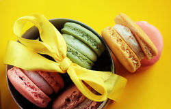 Photo of dessert on the yellow backround. Food photo. Photo of dessert. Mcarans on the yellow backround. Macarons in the box with yellow ribbon. Tasty dessert Stock Photos