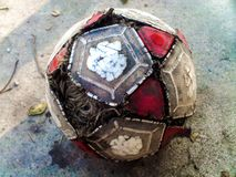 The Ball Carries Our Feelings. Photo of a deteriorated indoor soccer ball with real background royalty free stock photography