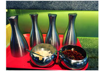 Photo of different sauces and condiments on a table in a cafe Stock Photo