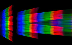 Photo diffraction light candles on the two diffraction gratings Royalty Free Stock Photos