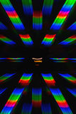 Photo of the diffraction pattern of light from incandescent spiral, obtained with the help of two diffraction gratings Stock Photography
