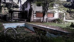 Photo of a Dilapidated Swimming Pool Royalty Free Stock Photography