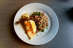Photo dishes with buckwheat and fish Stock Photos