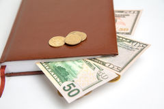 Photo of dollars and small change Royalty Free Stock Images