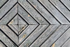 Photo of a door part of a diamond-shaped wood, background, wood texture stock image