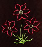 A photo of a drawing of three flowers on a tablet. Royalty Free Stock Photo