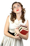 Photo of the dreaming woman with books Royalty Free Stock Photos
