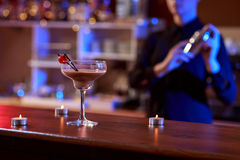 Photo of a drink. With a barman in the background Stock Photo
