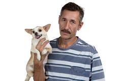Photo du vieil homme et de son petit chien Photographie stock libre de droits