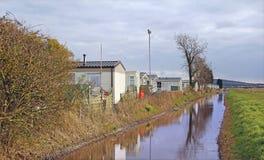 Caravans along tow path canal Stock Photos