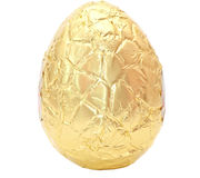 Photo of an easter egg wrapped in gold foil. Isolated on a plain white background with clipping path Stock Photo