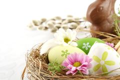 Photo easter eggs nest with flowers,chocolate hare,catkins Royalty Free Stock Image