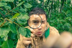 Photo of ecologist man with magnifying glass Royalty Free Stock Image