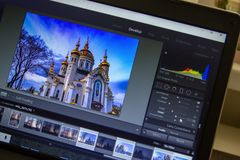 Photo editing on laptop. Photographer`s computer with professional software. Image post processing. Of travel photos royalty free stock photos