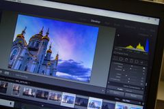 Photo editing on laptop. Photographer`s computer with professional software. Image post processing. Of travel photos royalty free stock photography